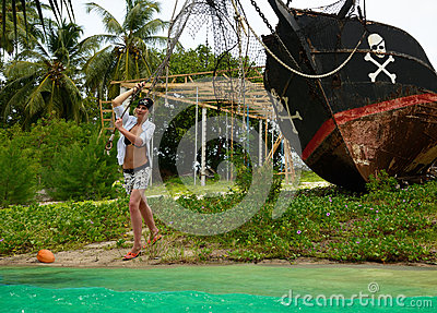 Girl launching pirates boat, journey.