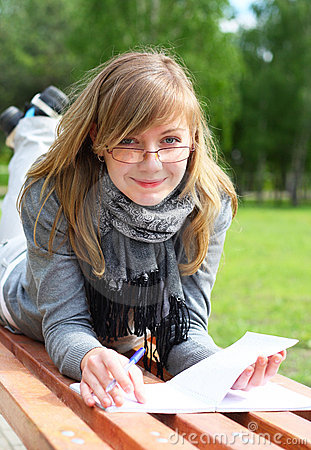 The girl lay on a bench, and write