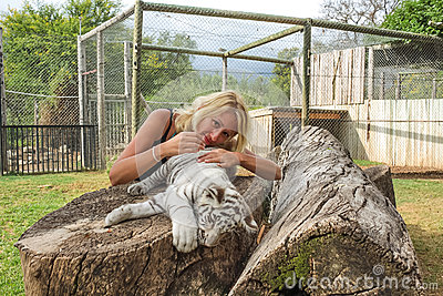 Woman with white puppy tiger
