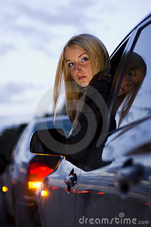 Girl leaning out car window