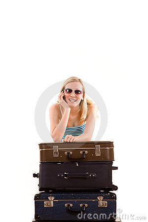 Girl leaning on suitcases