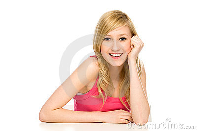 Girl leaning on table