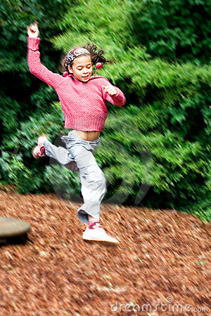 Free Girl Leaps High In Playground Royalty Free Stock Image - 2599346