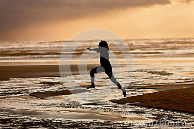 Girl Leaps Into The Water. Stock Photo