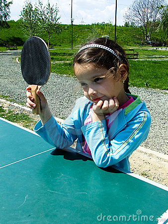 Girl learn to play ping-pong