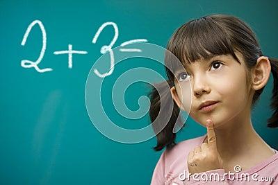 Girl learning math.