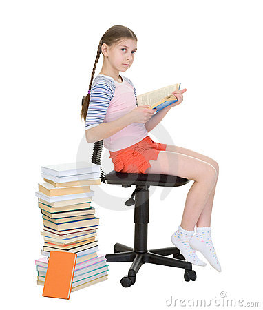 Girl learns lessons near big pile of books