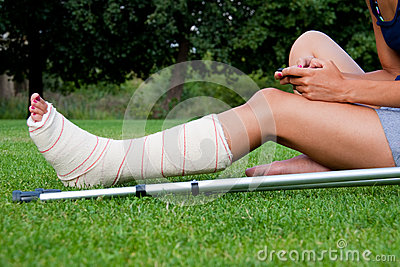 Girl with leg in plaster chatting