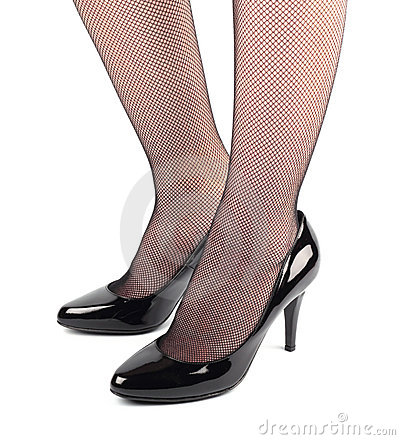 Girl legs in black patent leather  shoes