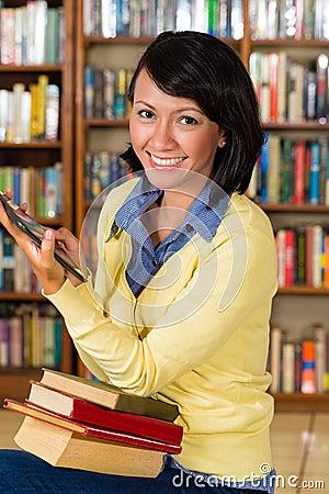 Girl at library reading a e-book