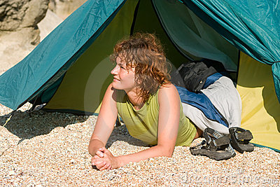 Girl lie near of tent