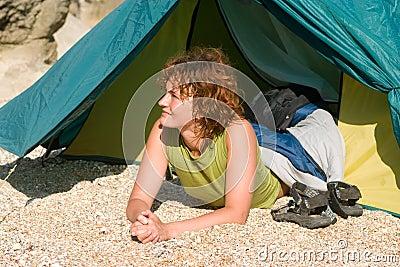 Girl lie near of tent