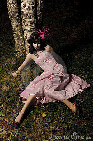 Girl lie near tree