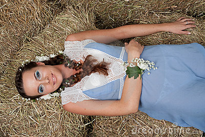 Girl lies on the hay