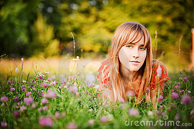Girl lies on lawn