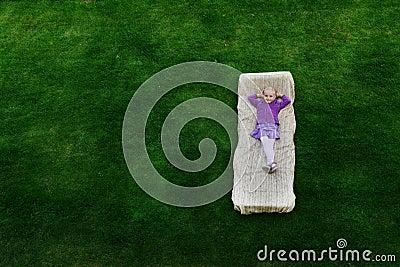 Girl  lies on mattress