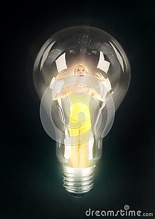 Girl lighting in bulb