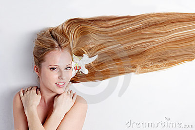 Girl with lily flower in hair