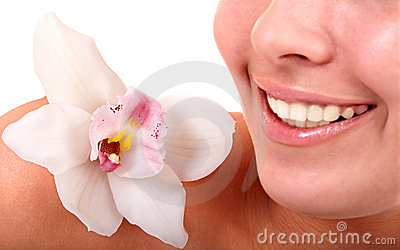 Girl lips and orchid flower. Spa salon.