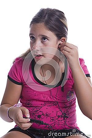Girl listen to music on the headphones