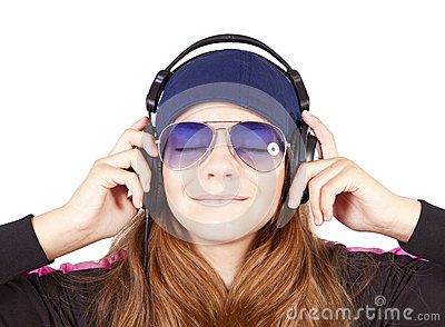 Girl listening music by headphones over white