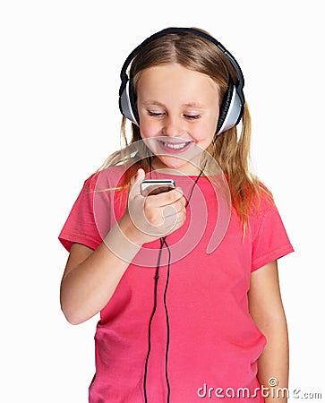 Girl listening to music against white