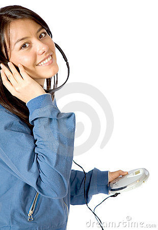 Girl listening to music on a cd player