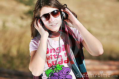 Girl listening to music with headphones