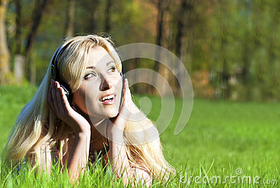 Girl listening to music in nature