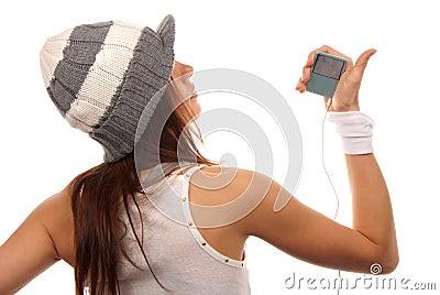 Girl listening to music in white headphones
