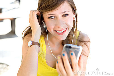 Girl listening tp mp3 player