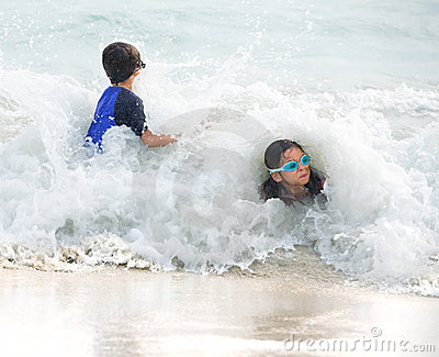 Girl and little brother hit by big wave