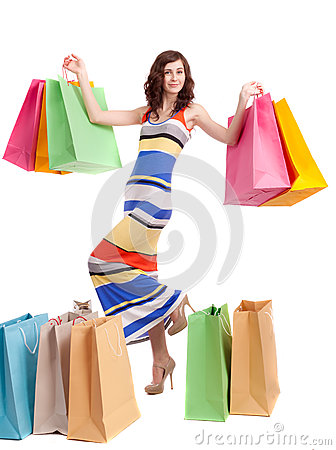 A girl in a long dress color with shopping bags