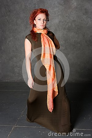 The girl in a long dress with an orange scarf