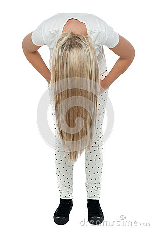 Girl with long hair bending down