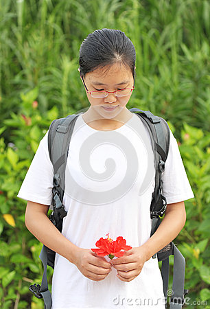 girl look flower in hands