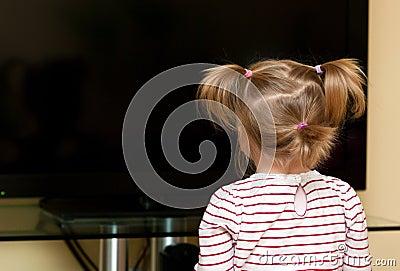 Girl looking at blank tv
