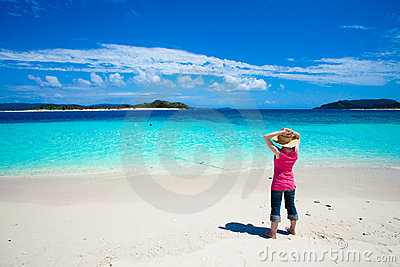 Girl looking at the deserted tropical islands