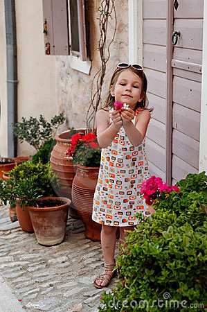 Girl looking at flowers