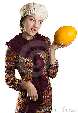 Girl looking at fruit with disaproval
