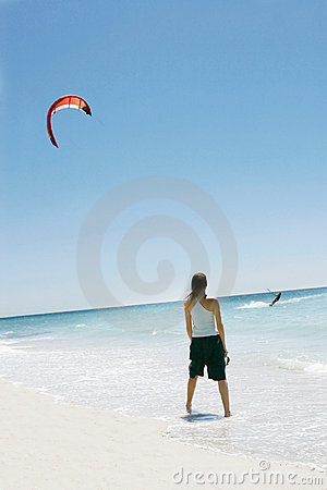 Girl looking at kite surfer