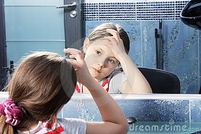 Girl looking at mirror