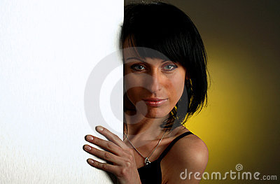 Girl is looking out-of the white empty board
