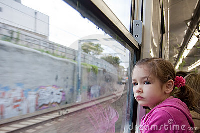 Girl looking out window of train
