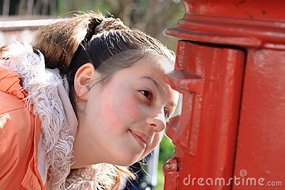 Girl looking in post box