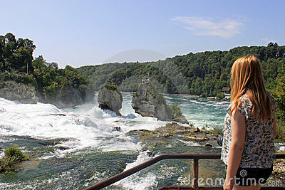 Girl looking at the Rhine Falls in Switzerland