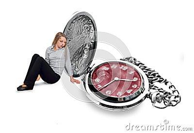 Girl looking sad at silver pocket watch