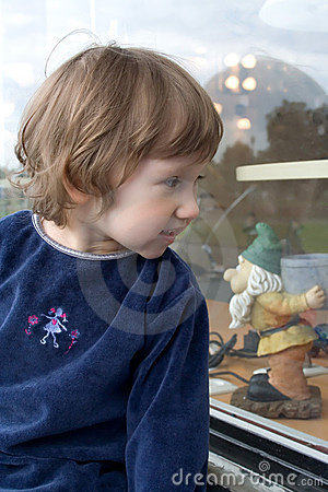 Girl looking at shop window