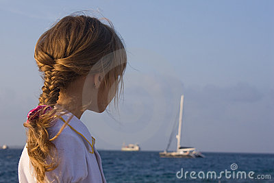 Girl looking to the yacht