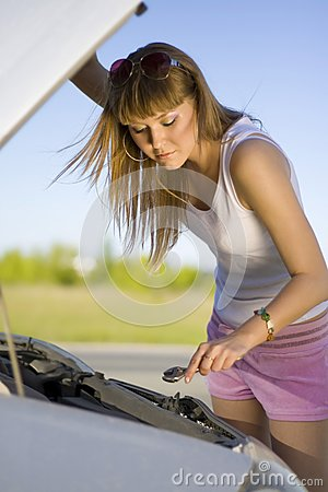 Girl looking under the car
